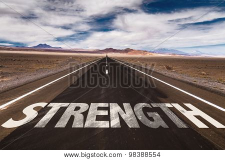 Strength written on desert road