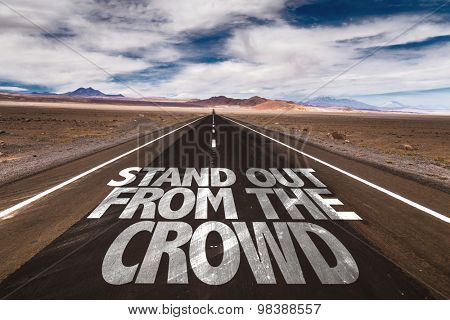 Stand Out From The Crowd written on desert road