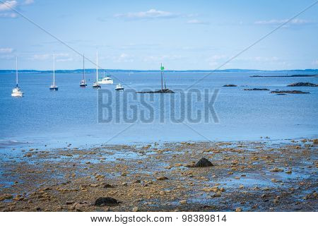 beautiful ocean shore with boats in the water in Biddeford, Maine, USA