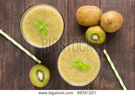 Kiwi Smoothie With Fresh Fruits On Wooden Background. Top View