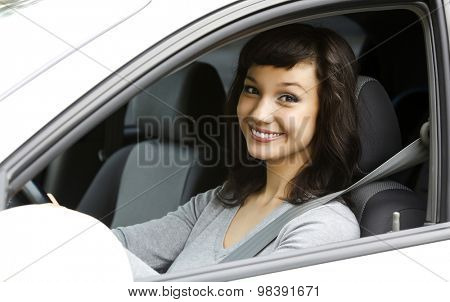 Pretty female driver in a white car