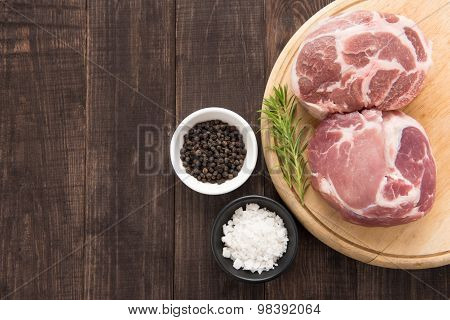 Top View Raw Fresh Meat And Garlic, Pepper On Wooden Background