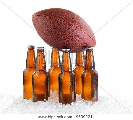 Six Pack Of Ice Cold Bottled Beer With American Football Isolated On White Background