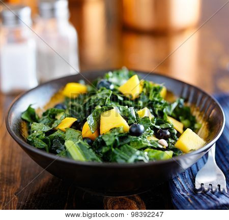 bowl of healthy mango and kale salad