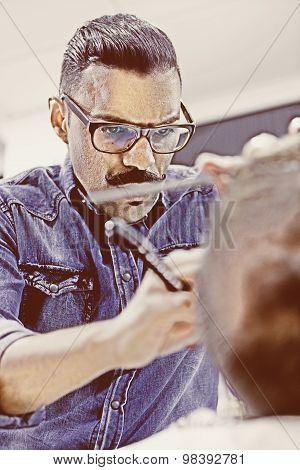 Hairstylist Shaving A Beard.