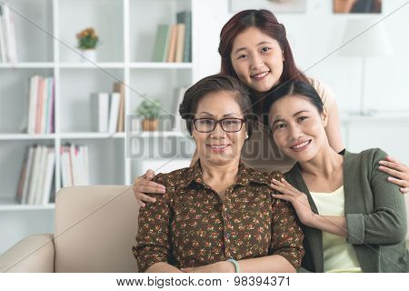 Embracing mother and grandmother