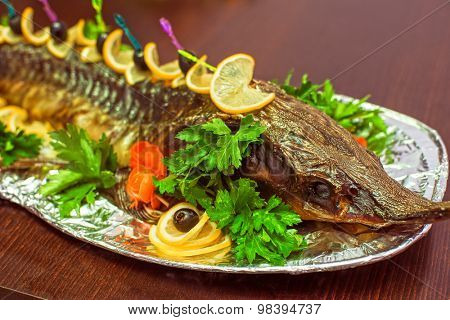 sturgeon baked with greens fruits and vegetables