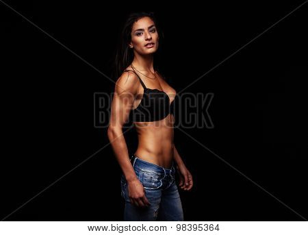 Young Woman Posing In Sexy Bra And Jeans