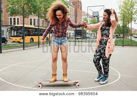 Woman Learning To Ride Skateboard