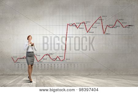 Cheerful businesswoman playing fife and diagrams at background