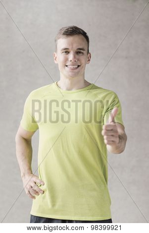 sport, fitness, lifestyle and people concept - smiling man showing thumbs up in gym