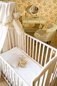 baby room with crib and toys