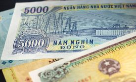 stock photo of dong  - Banknote in five thousand Vietnamese dong close up - JPG
