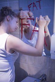foto of hate  - Image of slim beautiful woman hating her body - JPG