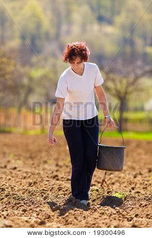 Young Woman Farmer Planting
