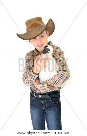 Child Holding A Bantam