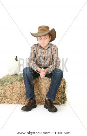 Country Boy Sitting On Lucerne Bale