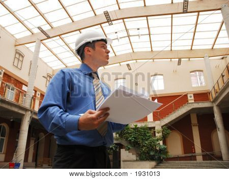 A Construction Worker Looking At Plans