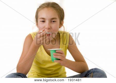 Girl Eating Yoghurt Ii