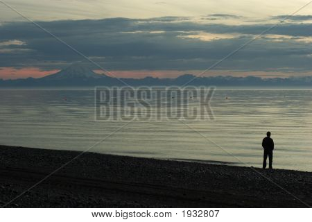 Cook Inlet Beach Sunset With A Man Silouette