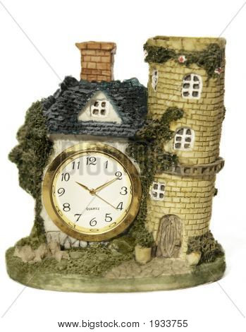 Clock In A Form Of Old House With Tower