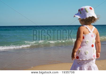 Young Girl Looking At The Sea