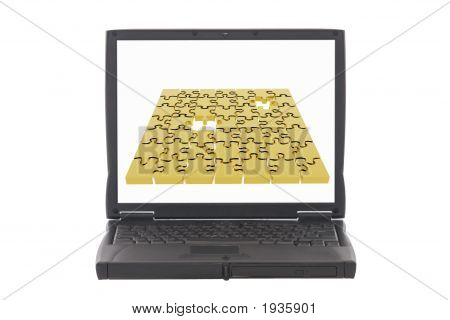 Laptop With Jigsaw Puzzle On Screen
