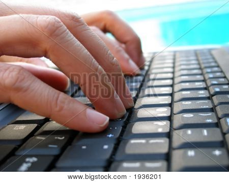 Fingers Typing On Computer Keyboard