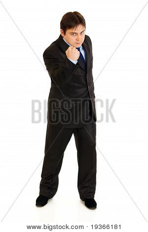 Full length portrait of angry businessman threaten with fist isolated on white