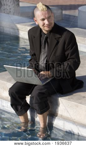 Punk Businessman With Feet In The Water