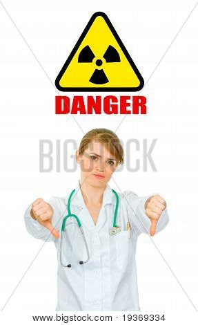 Concept- radiation danger! Displeased medical doctor woman showing thumbs down gesture isolated