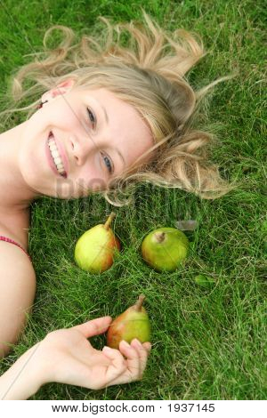 Woman Lying On Grass, Smiling