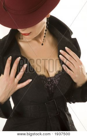 Clous-Up Of Woman'S Chest And Lower Part Of Her Face Covered By Hat.