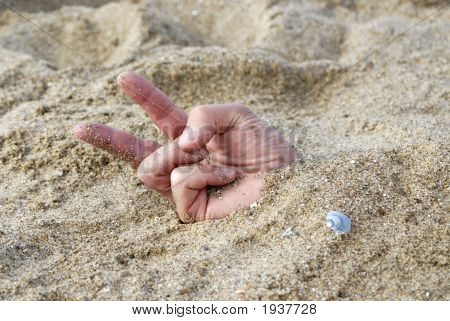 Hand Burried In The Sand