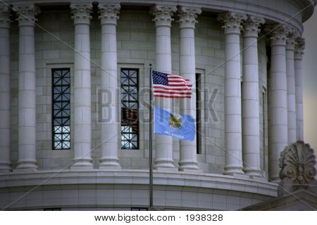Oklahoma And American Flag In Front Of Capitol Building.