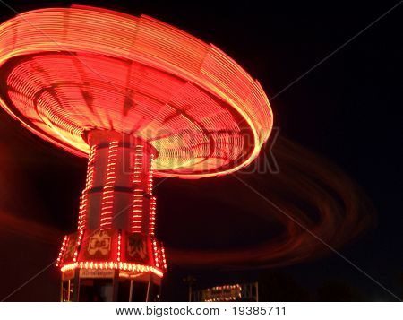 a ride a the fair at night with a slow shutter speed