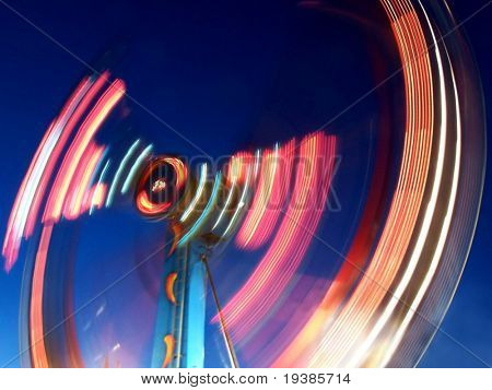 a ride at the fair with a long exposure at night