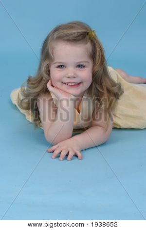 Girl In A Blue Studio Smiling