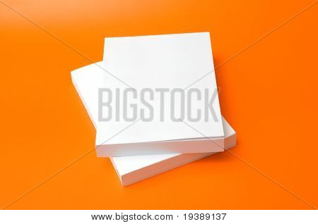 two blank books over an orange background