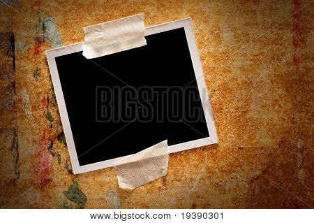 Blank instant photo over wooden background