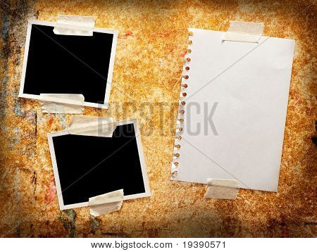 Two blank photos with paper