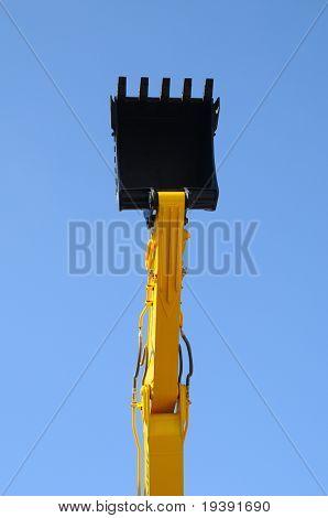 Bulldozer shovel opposite blue sky