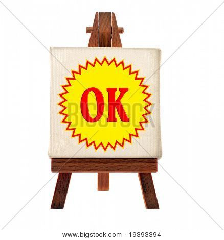white easel with okey text
