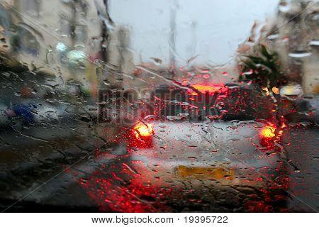 Rain behind glass of the car