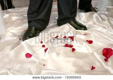 The Jewish wedding. The groom breaks a glass