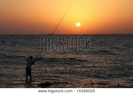 The fisherman on a sea decline