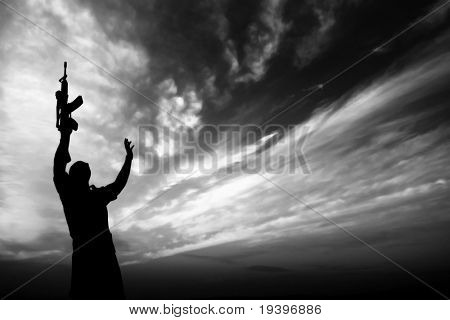 Silhouette of the soldier with the weapon