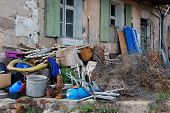 stock photo of waste reduction  - the old house and the waste materials - JPG