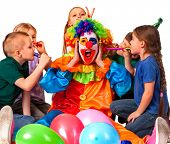 Birthday child clown playing with children. Kid cakes celebratory in hands of events organizer man.  poster