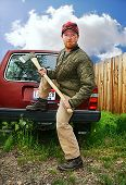 stock photo of redneck  - a redneck man with an ax in his hands - JPG